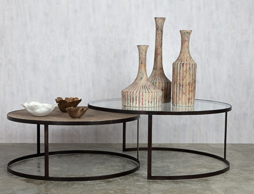 Round low tables with vases and serving bowls